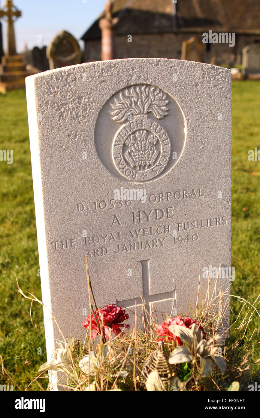 War grave for a Corporal of the Royal Welch Fusiliers killed in 1940 during World War 2 with flowers in Pembridge - Stock Image