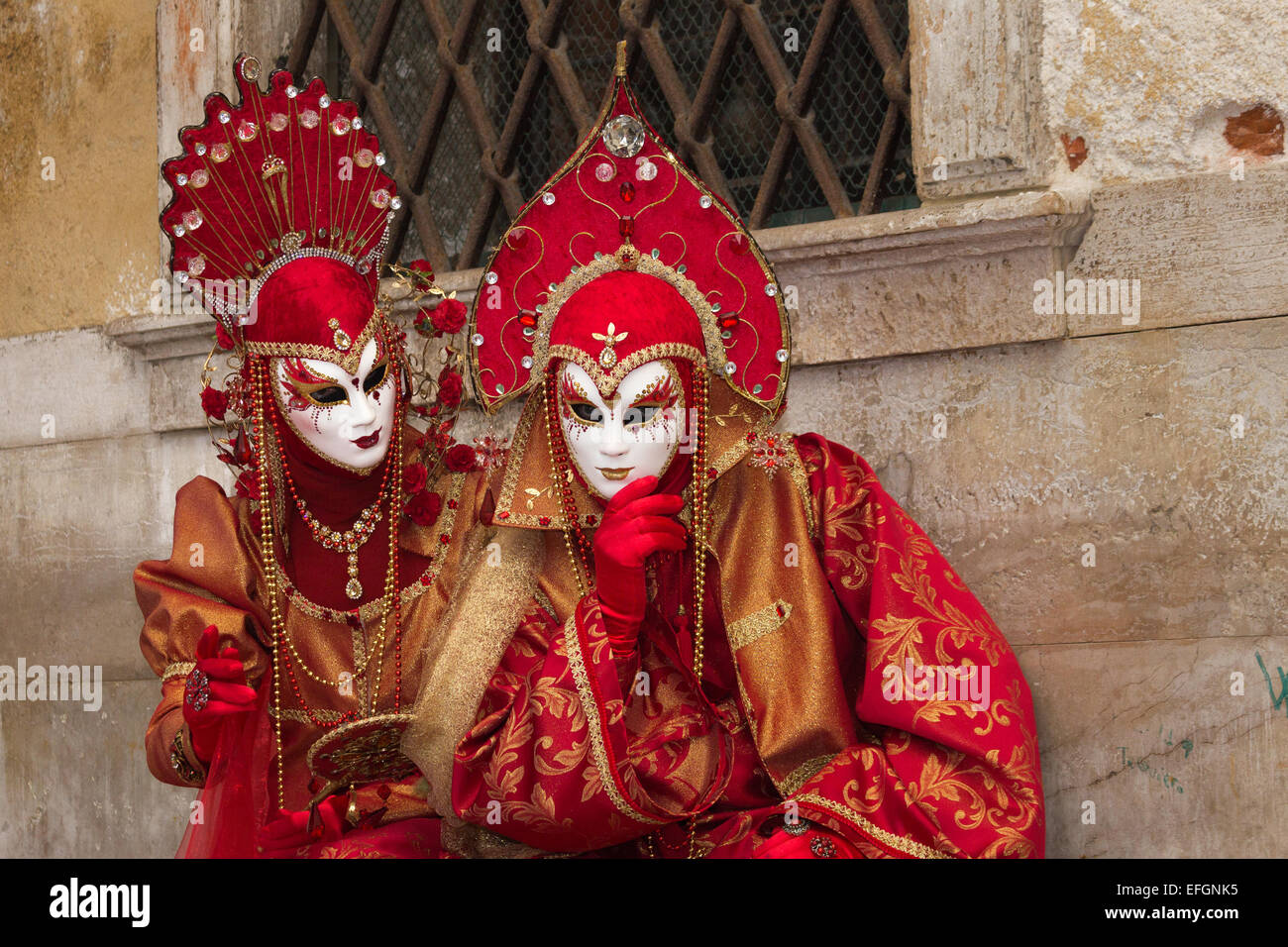 Costumed couple on the Piazza San Marco during Venice Carnival in Venice, Italy. Stock Photo