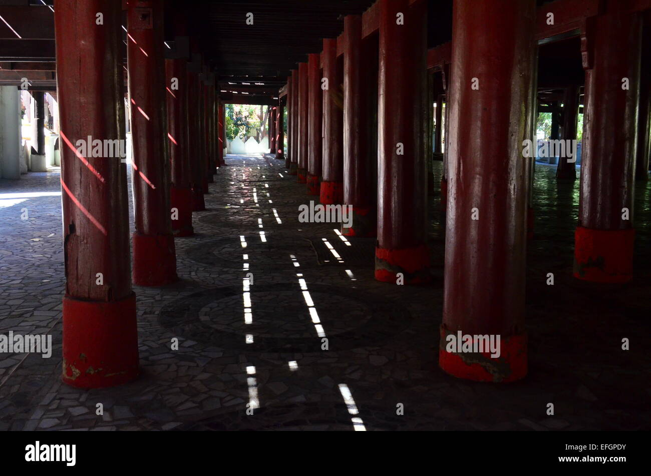 Shadows in monastery showing the correct path to the light. - Stock Image