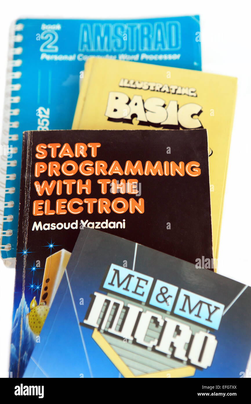 Old manuals for early basic computers, the Amstrad and Acorn Electron which were part of the home computing market - Stock Image