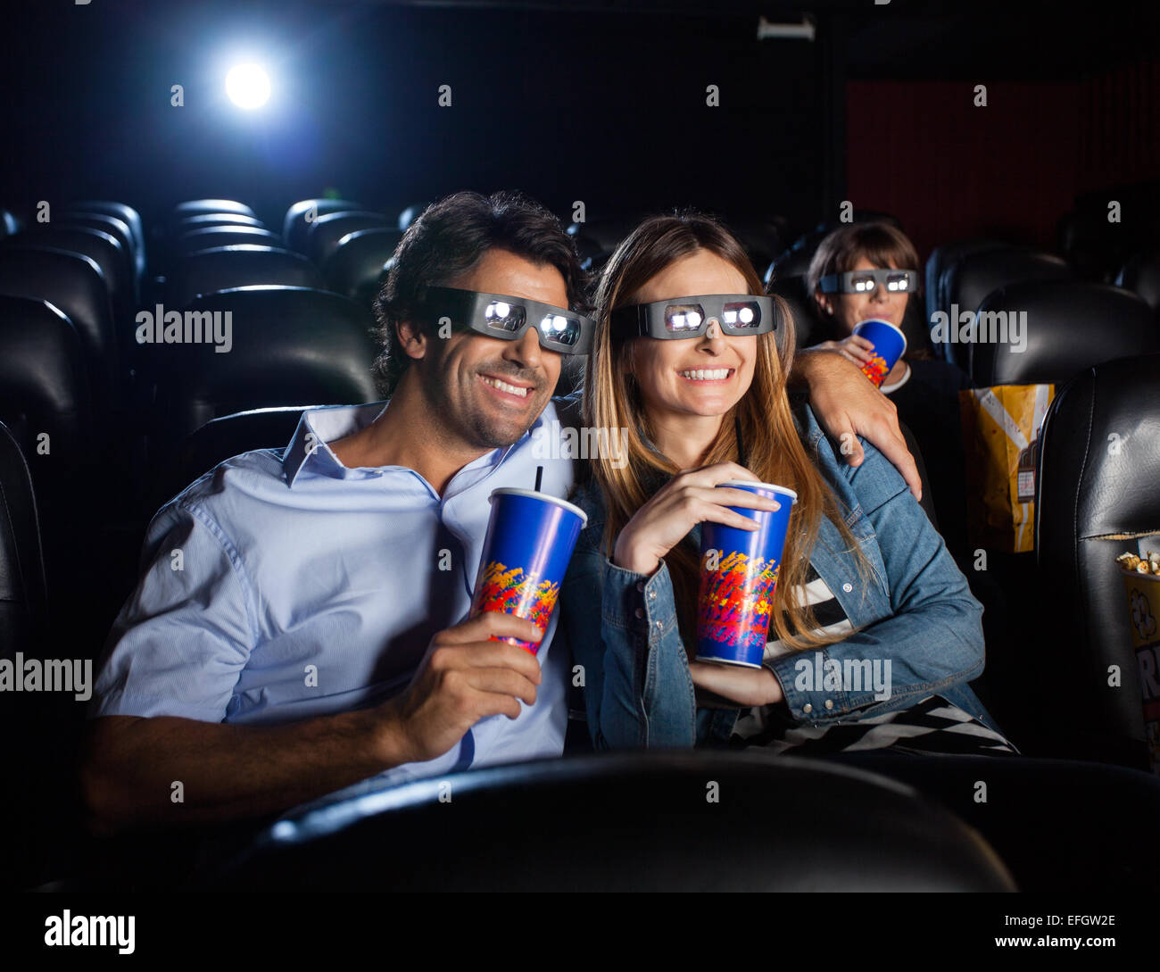 Happy Couple Watching 3D Movie In Theater - Stock Image