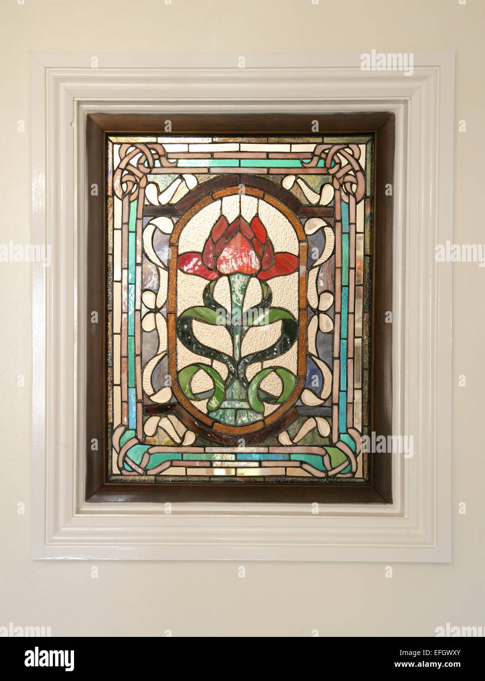 rose stain glass window in a frame - Stock Image