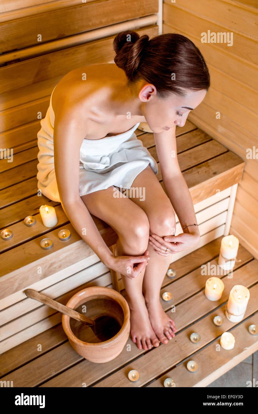 Woman in sauna - Stock Image