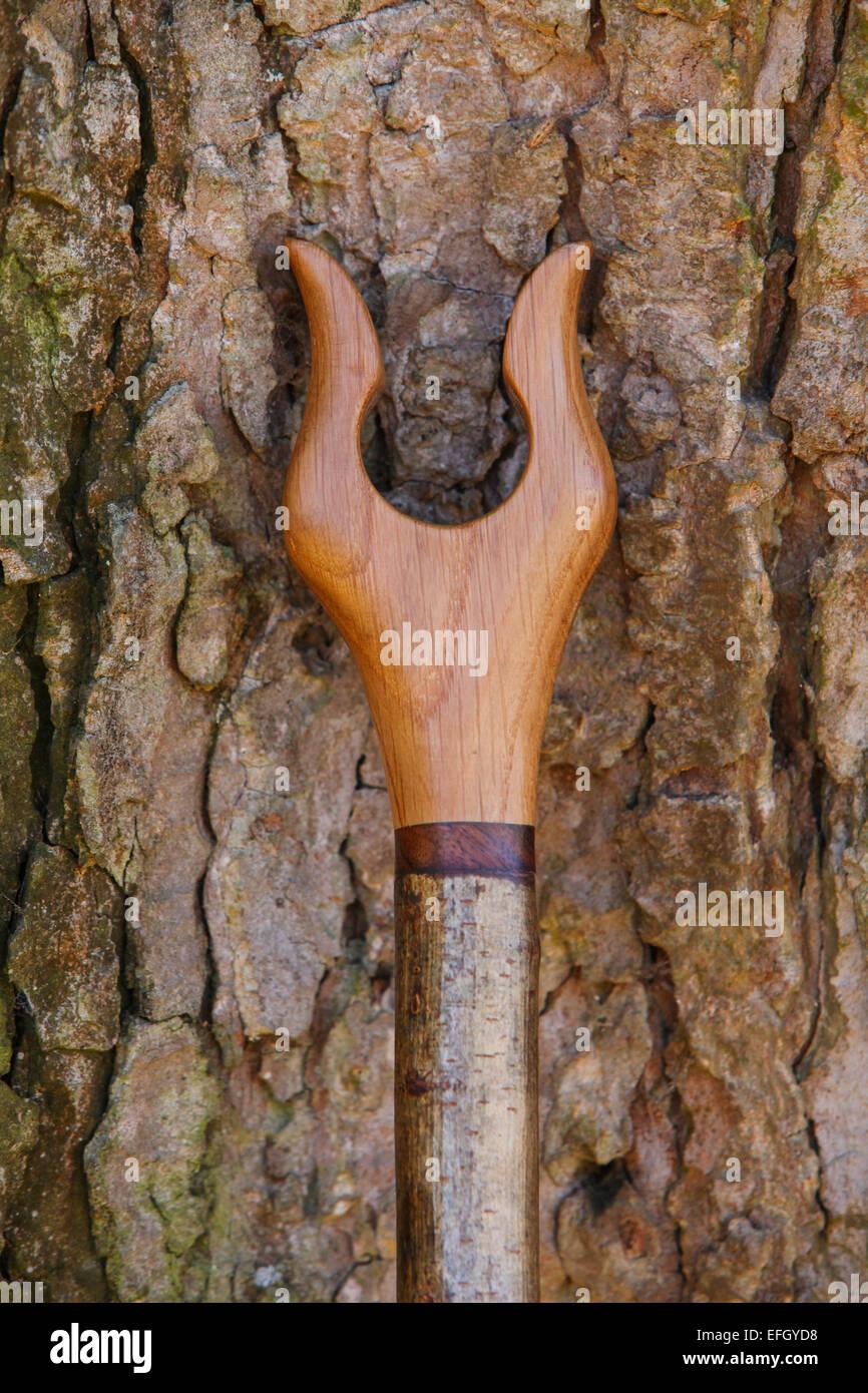 Traditional handcrafted hazel wood shepherds crook with oak lyre thumbstick handle - Stock Image