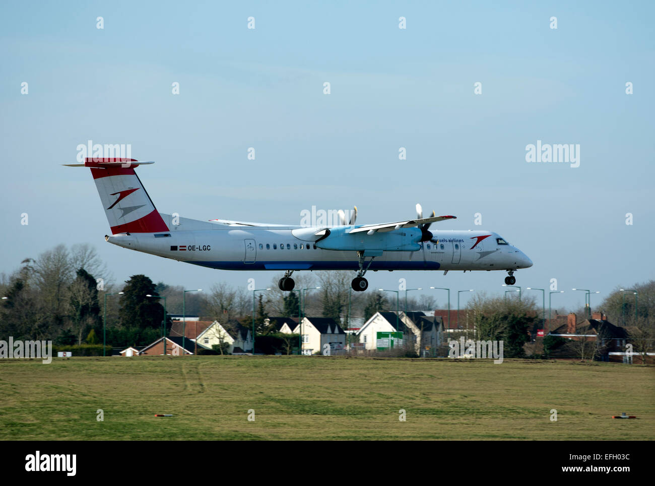 Brussels Airlines Dash 8 landing at Birmingham Airport, UK - Stock Image