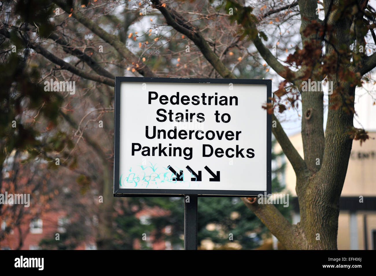 An undercover parking directions sign in London, Ontario. - Stock Image