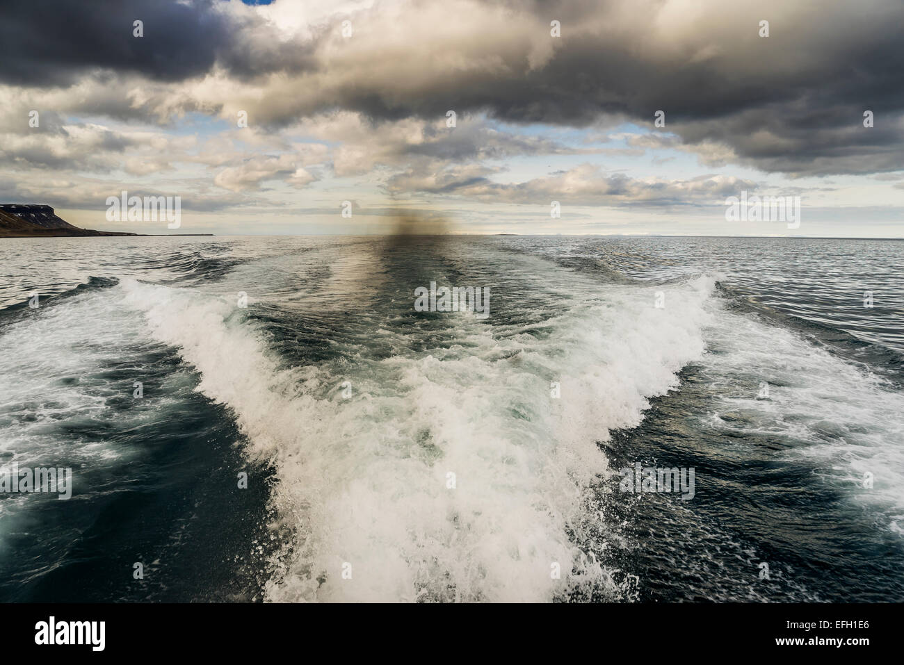 Waves and wake from speed boat, North Atlantic Ocean, Iceland - Stock Image