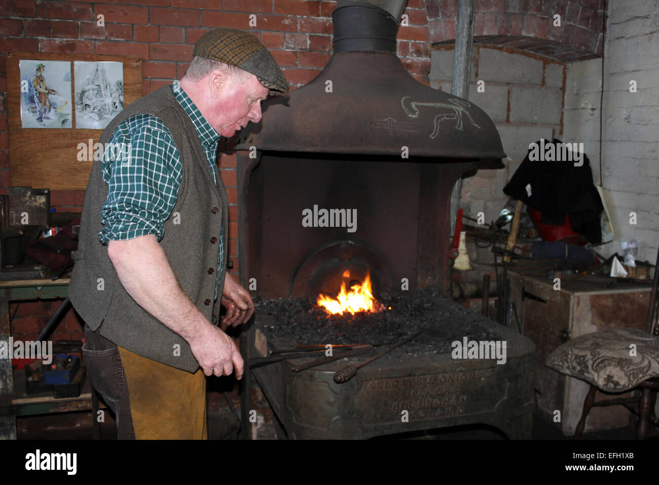 Elderly Blacksmith At His Forge - Stock Image