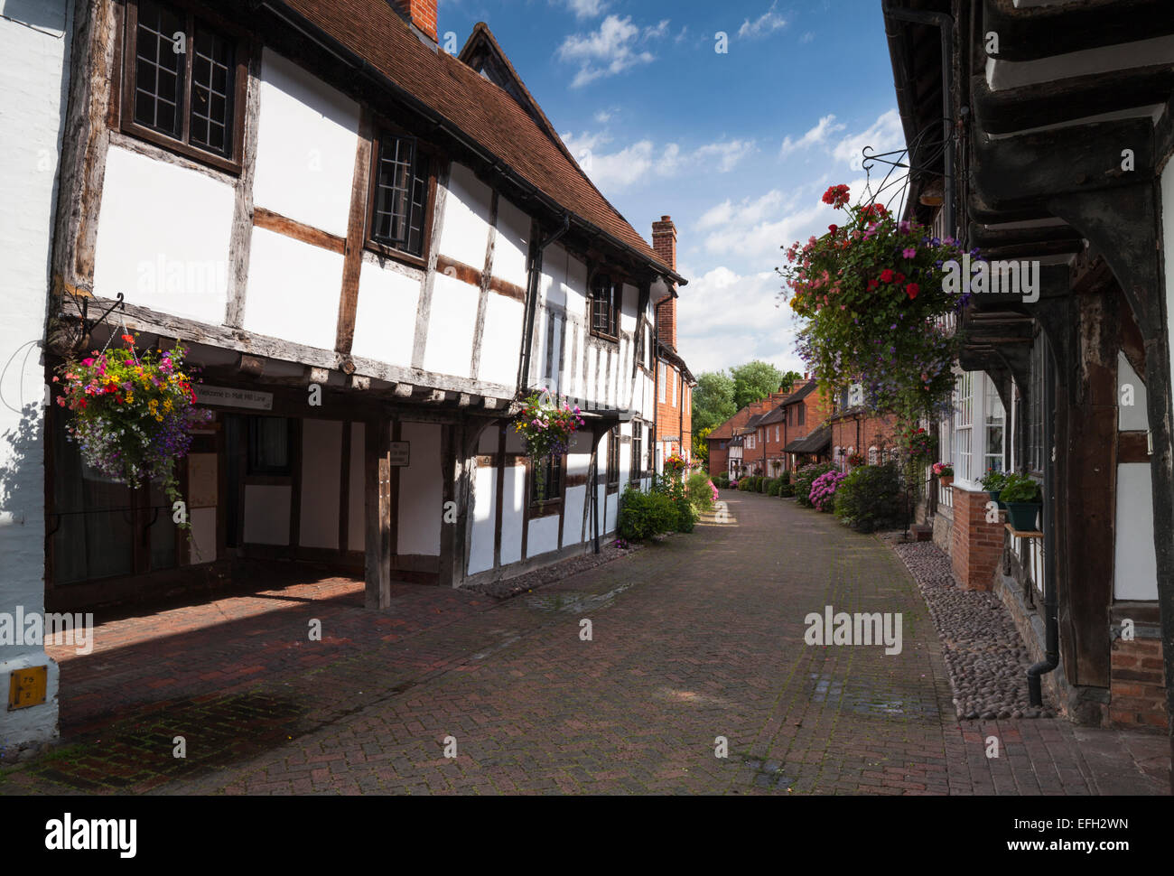 Beside medieval timber-framed houses looking down the historic Malt Mill Lane in Alcester, Warwickshire, England - Stock Image