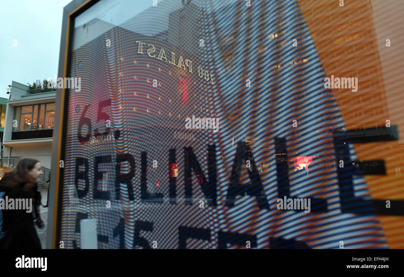 The illuminated facade of the cinema Zoo Palast is reflected in a Berlinale poster in Berlin, Germany, 04 February - Stock Image