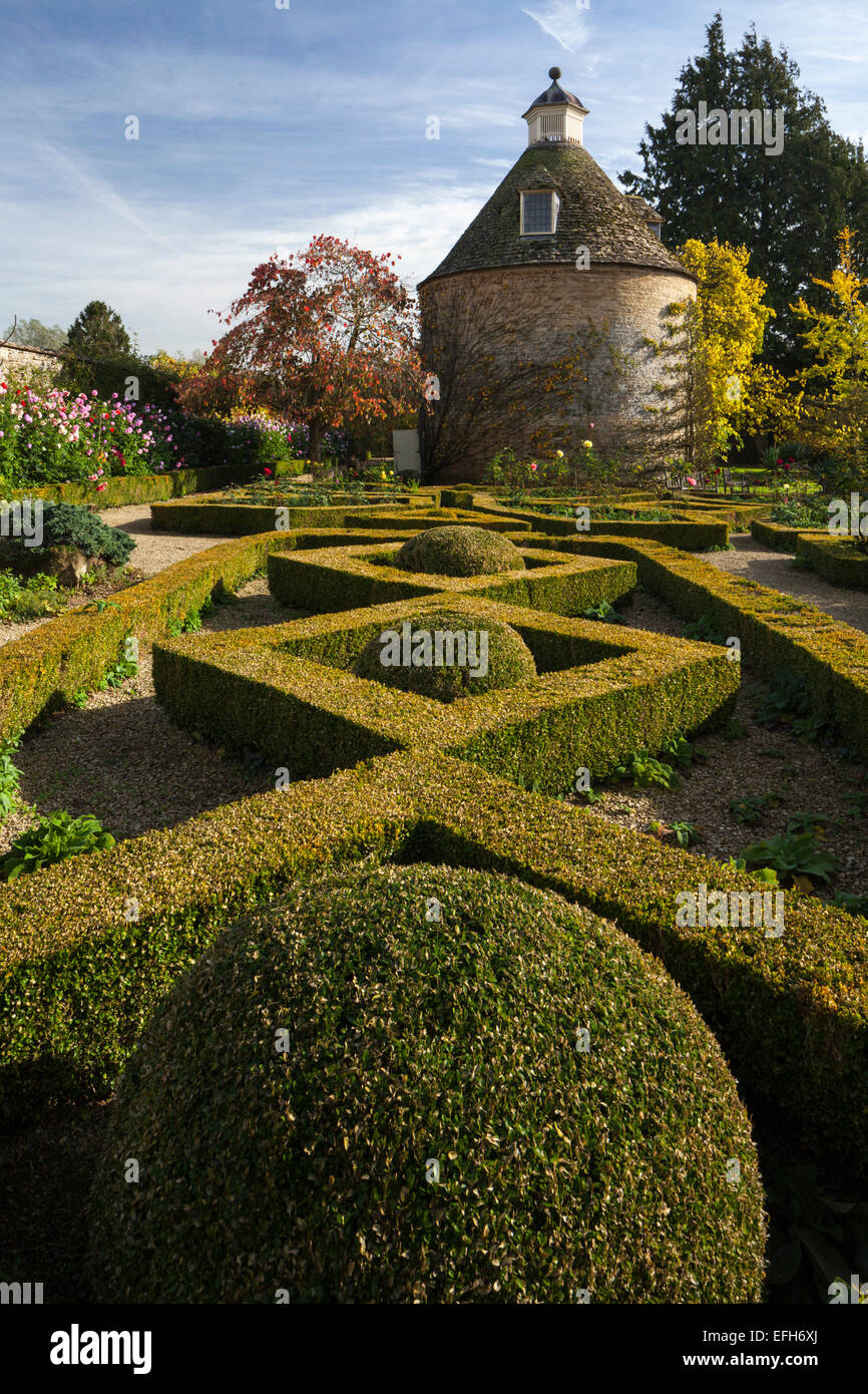 The geometric shape of the box hedge parterre and c.1685 dovecote in ...