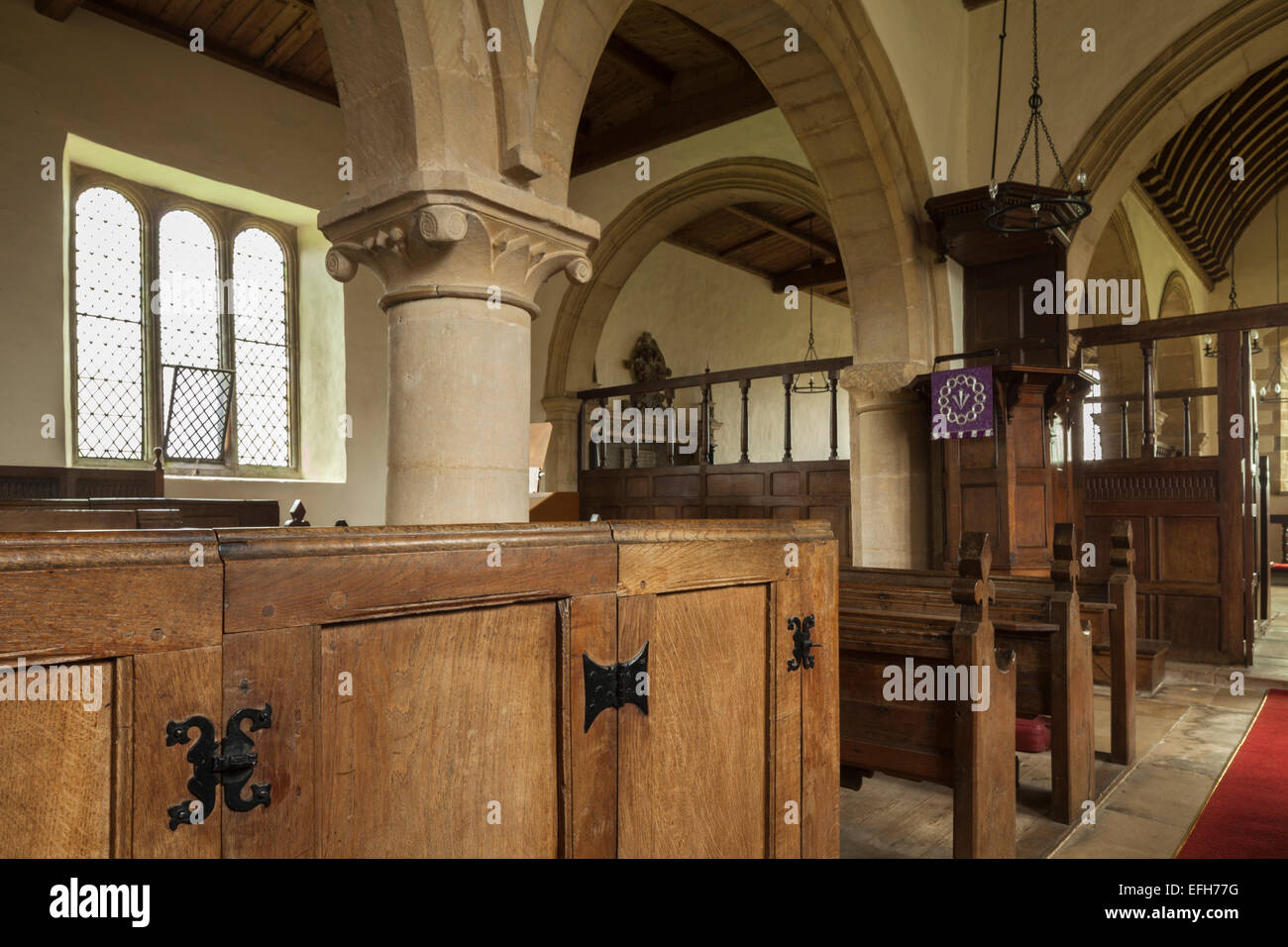 The original Elizabethan interior of St Peter's church in the tiny village of Brooke near Oakham, Rutland, England - Stock Image