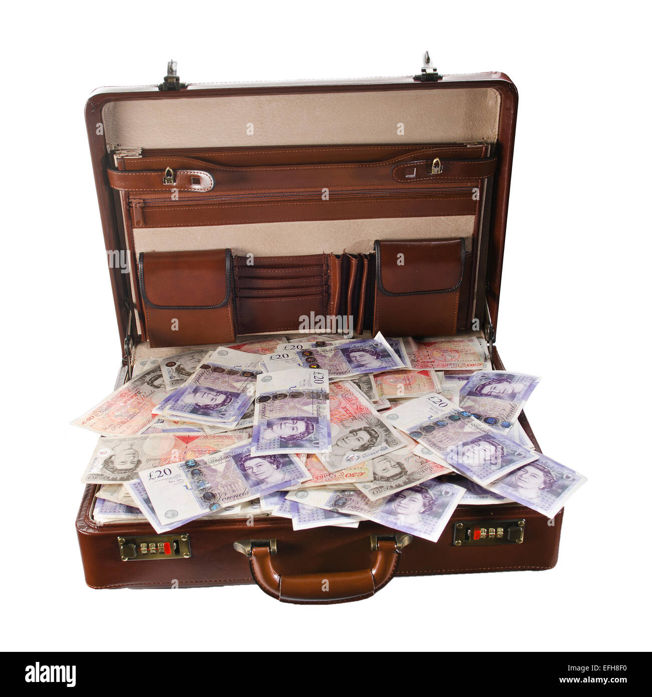 Attache case or briefcase full of UK British banknotes on a white background - Stock Image