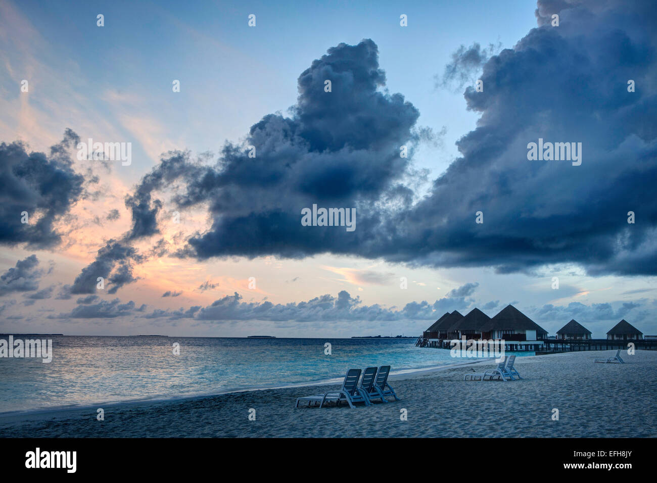Sunset over a beach on an Island in The Maldives - Stock Image