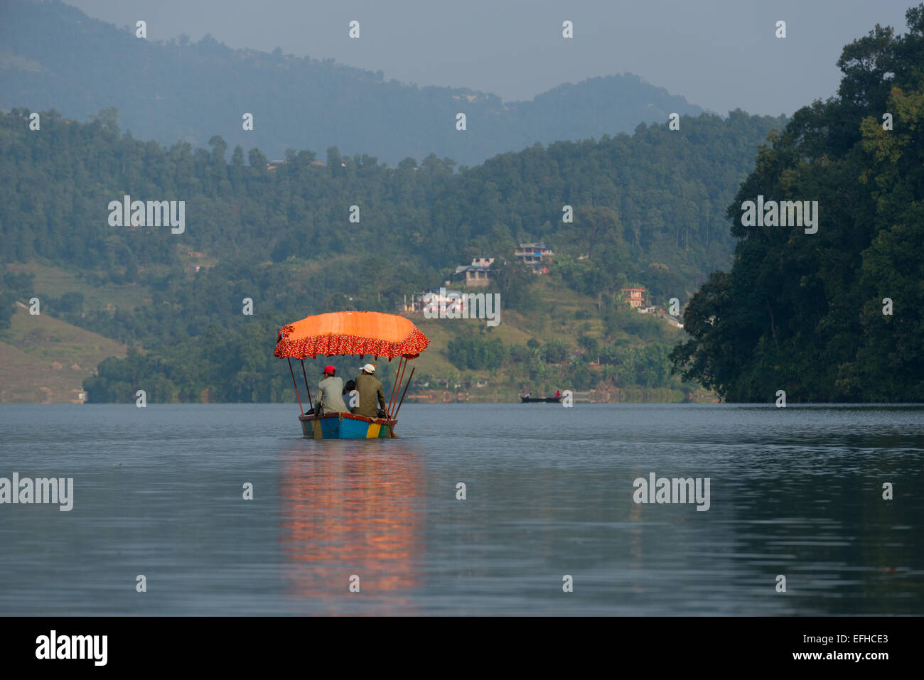 Tourist boat on Begnas Lake, near Pokhara, Nepal - Stock Image