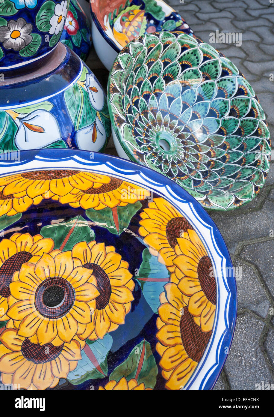 Colourful Pottery Sinks. For sale in a sidewalk market in Tulum Peublo. - Stock Image