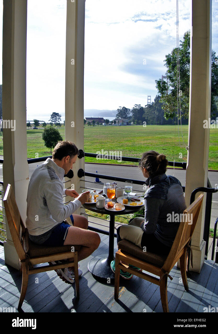 Couple Have Lunch On Porch Of Murray Circle Restaurant At