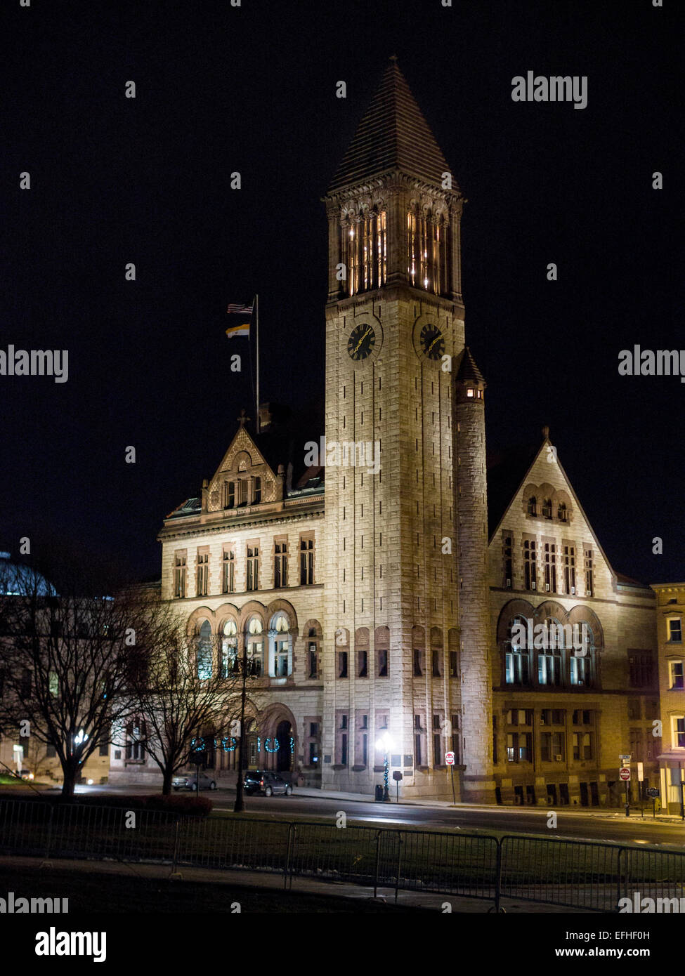 Albany City Hall at night. A floodlit City Hall, its high Venetian-style tower extends into the dark sky. - Stock Image