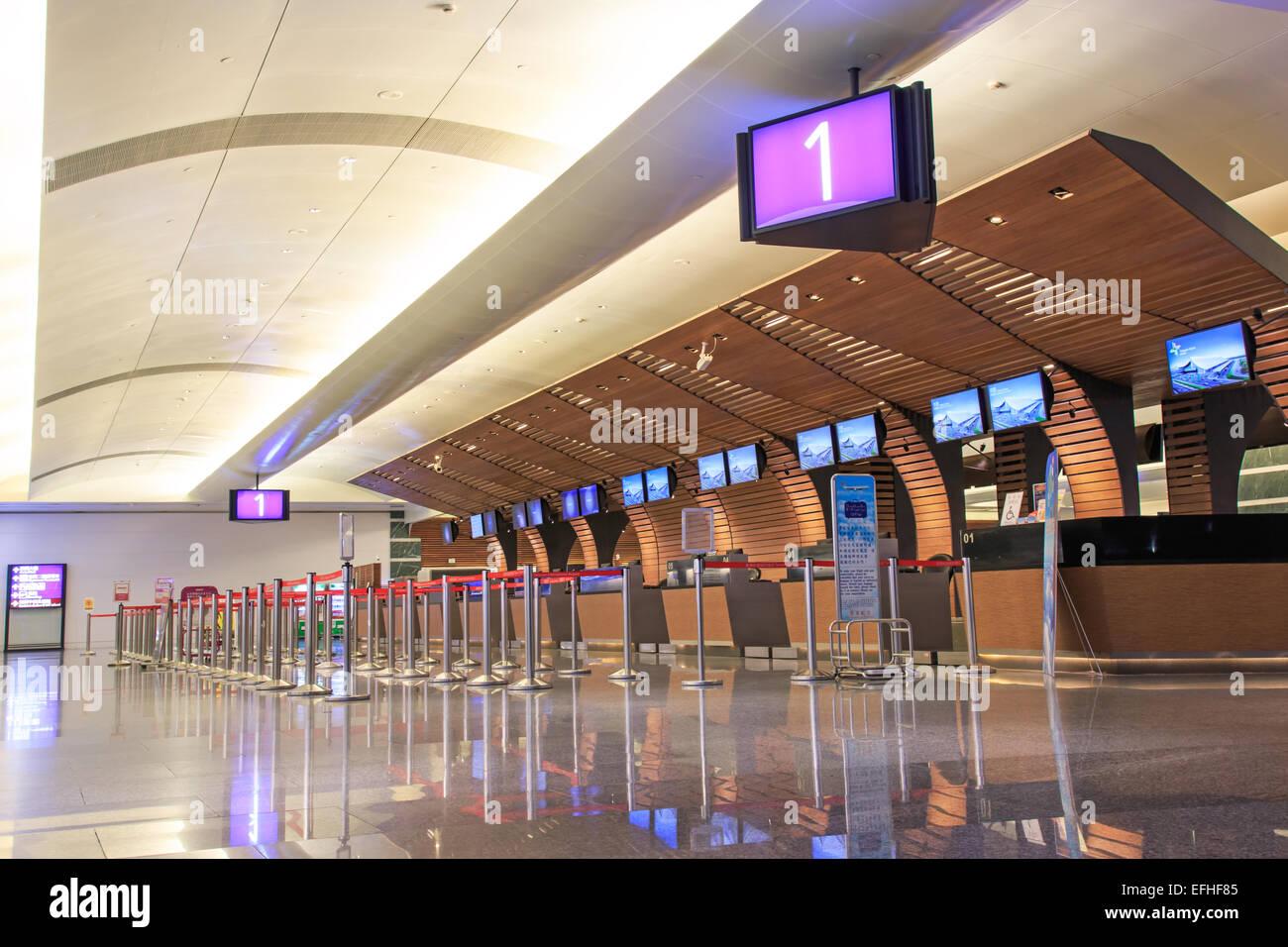 Taipei, Taiwan - January 9, 2015: Counters inside the Taiwan Taoyuan International Airport, the busiest airport - Stock Image