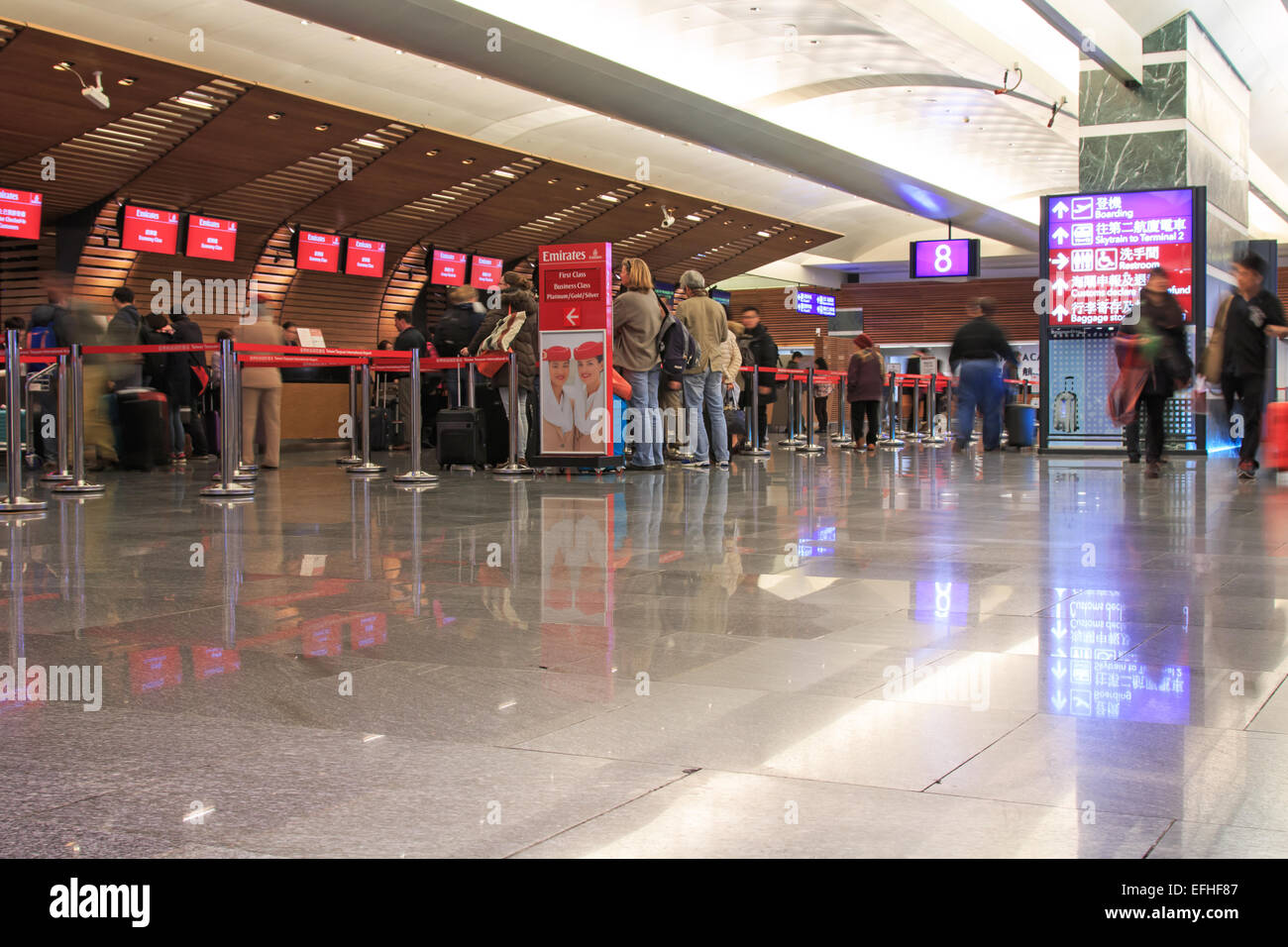 Taipei, Taiwan - January 9, 2015: People at the Emirates counters inside the Taiwan Taoyuan International Airport, - Stock Image