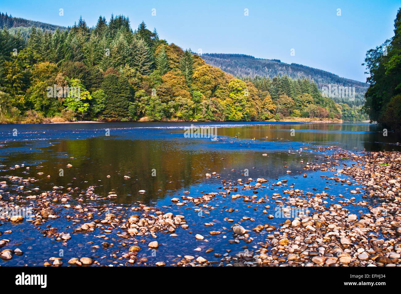 River Tay at Dunkeld, calm sunny autumn day, low water, stones exposed on river bed, Perth and Kinross, Highlands, Stock Photo