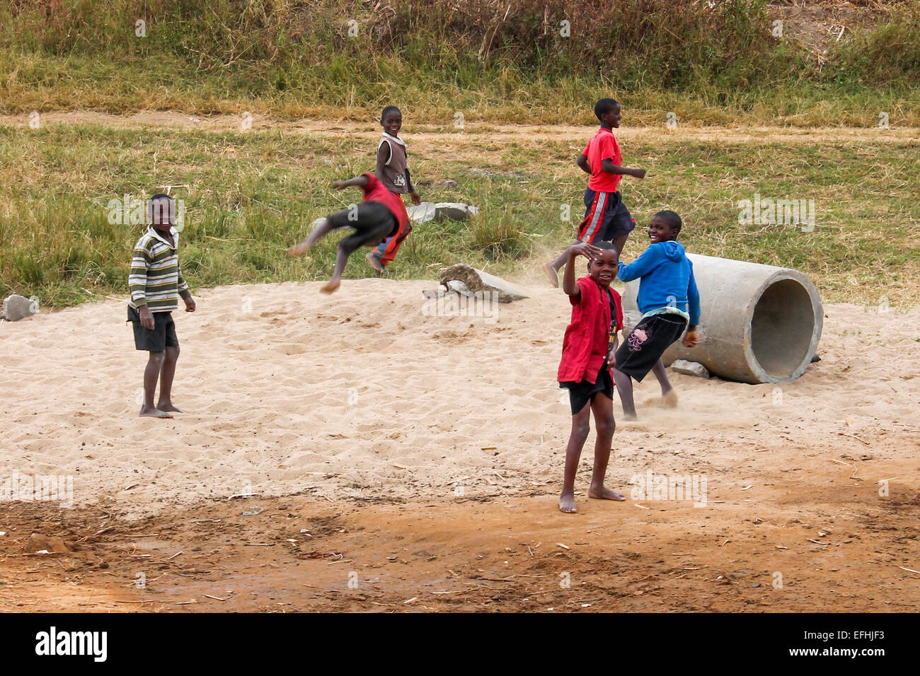 Young children entertain themselves for the day. - Stock Image