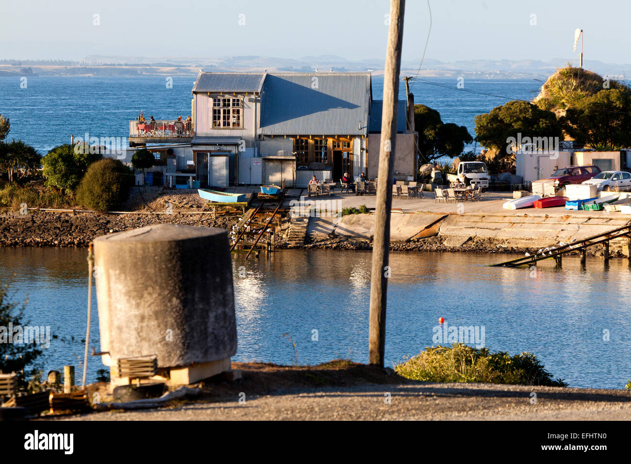Fleurs Place, well-known fish restaurant with corrugated iron architecture, Moeraki, Otago, South Island, New Zealand - Stock Image
