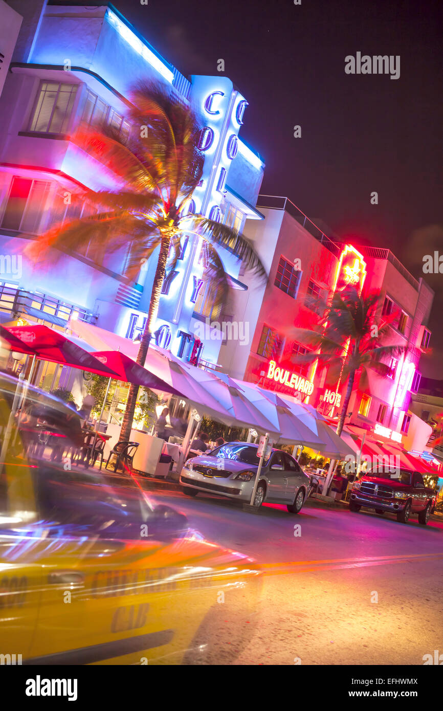 Ocean Drive at night with design hotel Colony, Art Deco District, South Beach, Miami, Florida, USA - Stock Image