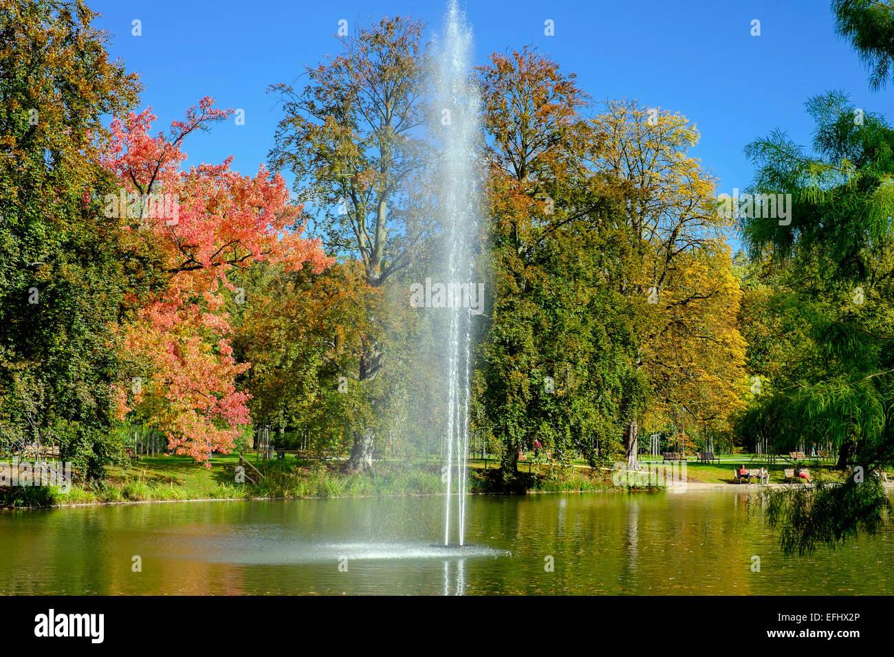 Water jet and pond Parc de l'Orangerie park Strasbourg Alsace France - Stock Image