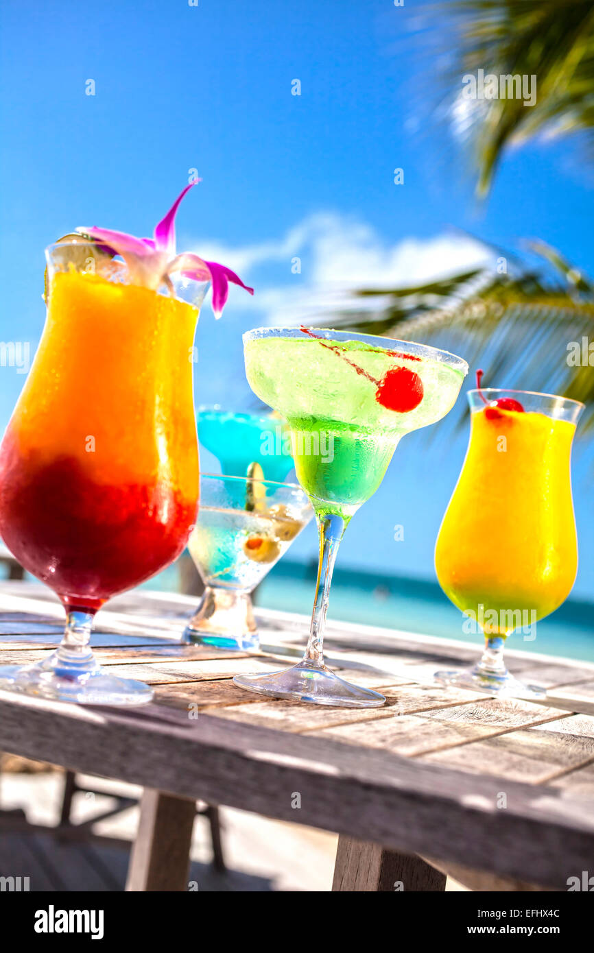 Table with tropical fruit cocktails, Little Palm Island Resort, Florida Keys, USA - Stock Image