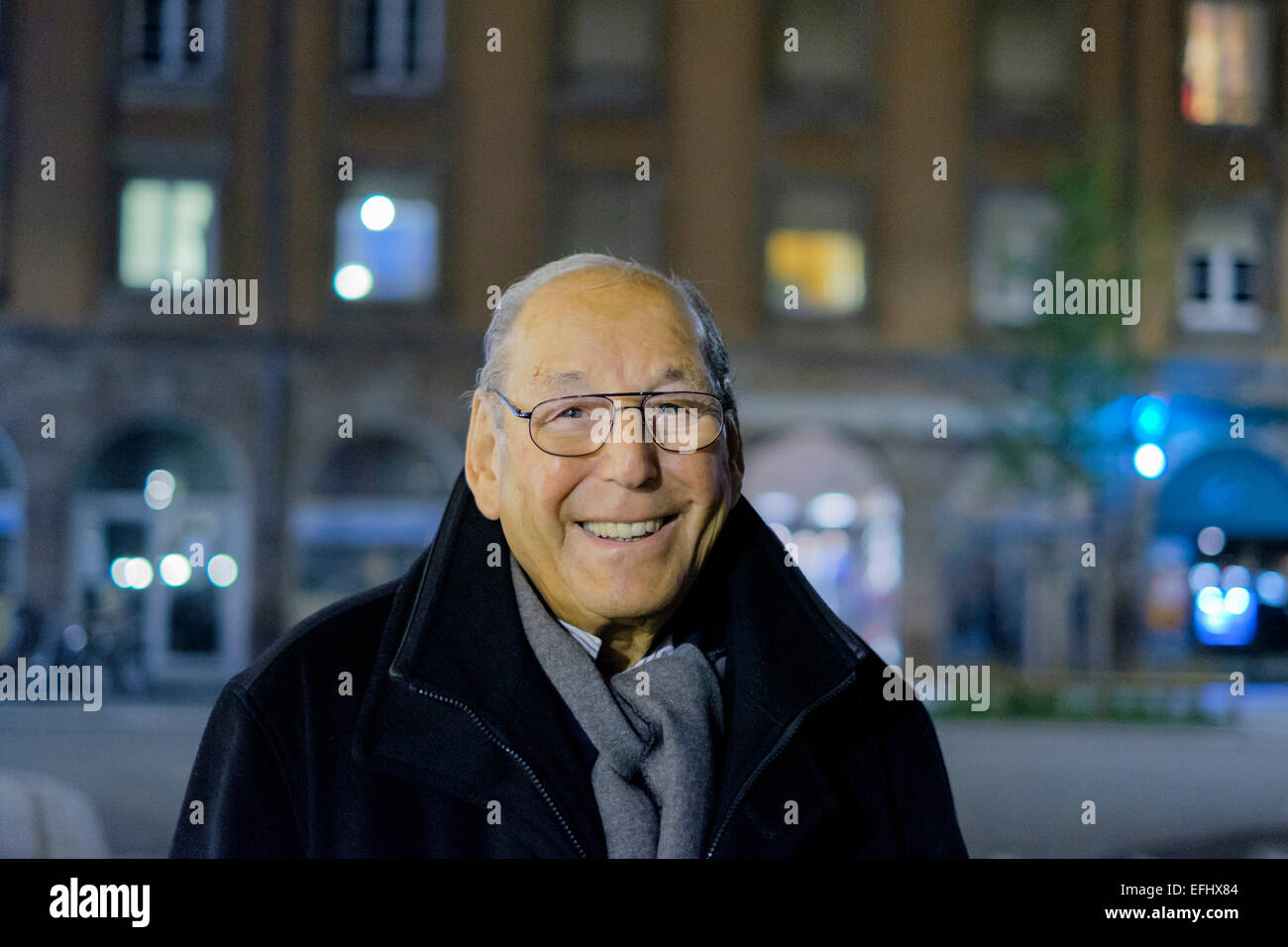 Smiling elderly man 80s portrait at night - Stock Image