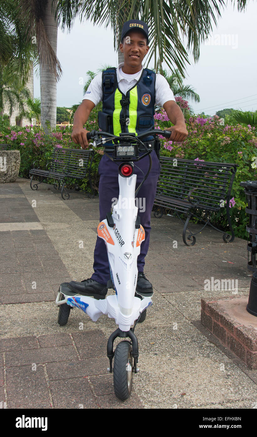 DOMINICAN REPUBLIC. A member of the Tourist Police patrolling the streets of Santo Domingo on a Trikke electric - Stock Image