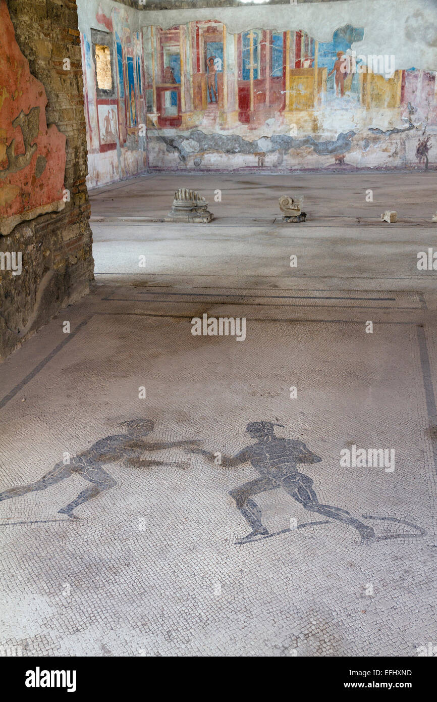 Mosaic of two athletes in the entrance corridor at house VII.2.23, historic town of Pompeii in the Gulf of Naples, - Stock Image