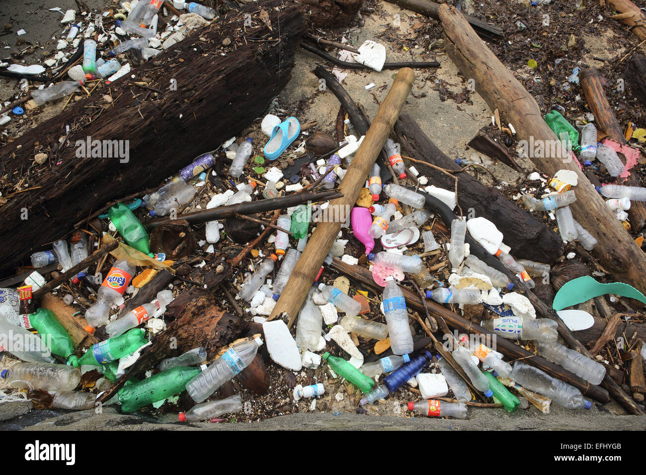 Plastic bottles and other trash polluting beach on Bunaken Island, Sulawesi - Stock Image