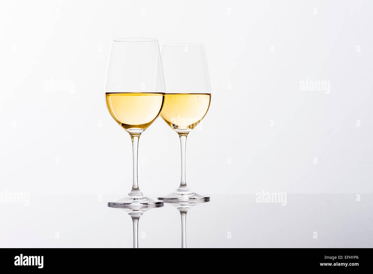 Two glasses of white wine, Hamburg, Northern Germany, Germany - Stock Image