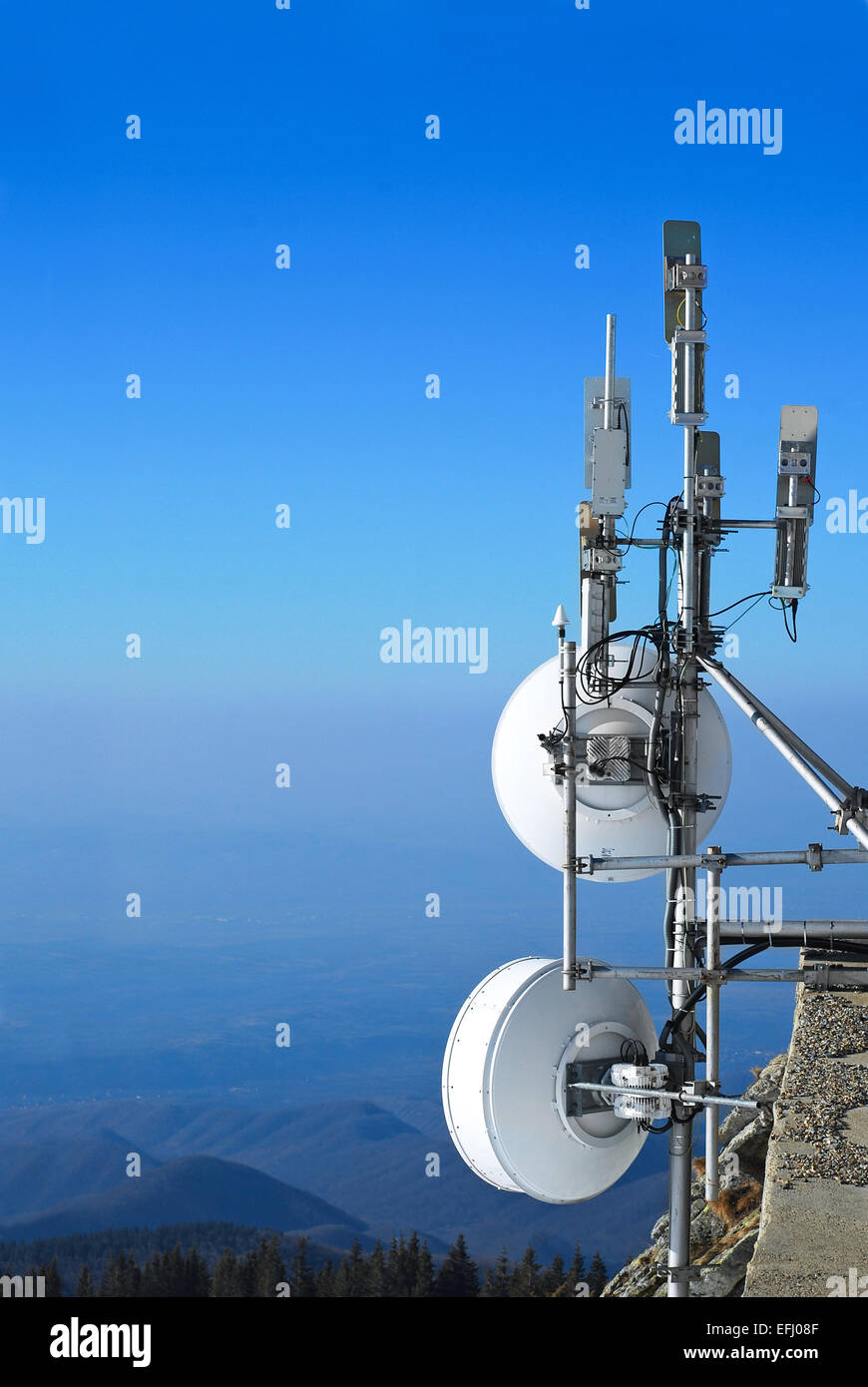telecommunication antennas group on mountain top - Stock Image