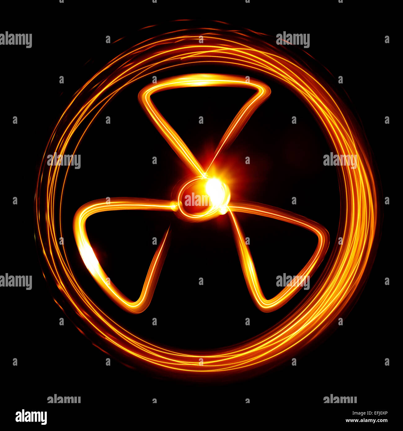 Radiation sign created by light - Stock Image