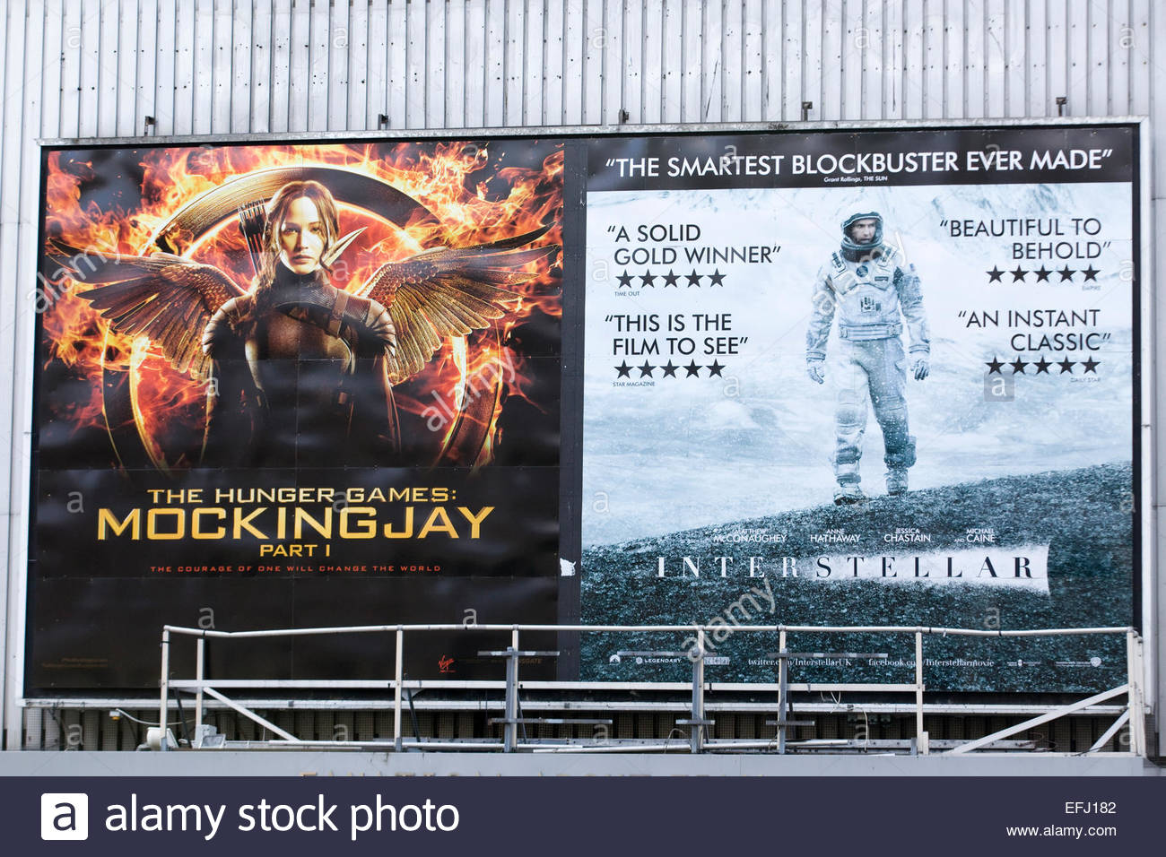 Poster advertising The Hunger Games Mockingjay Part 1and interstellar - Stock Image