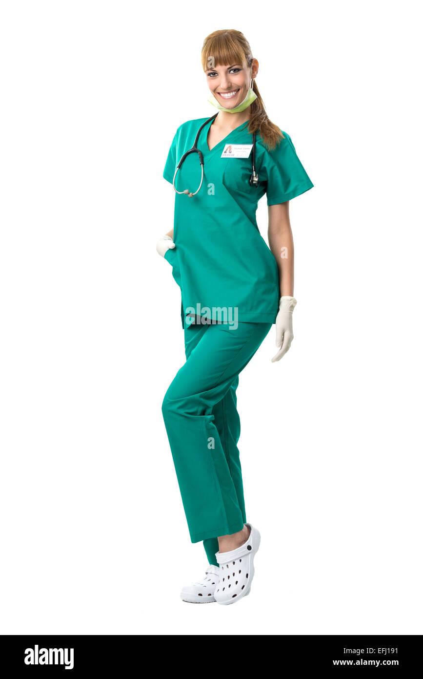 Pretty surgeon woman in a green dress - Stock Image