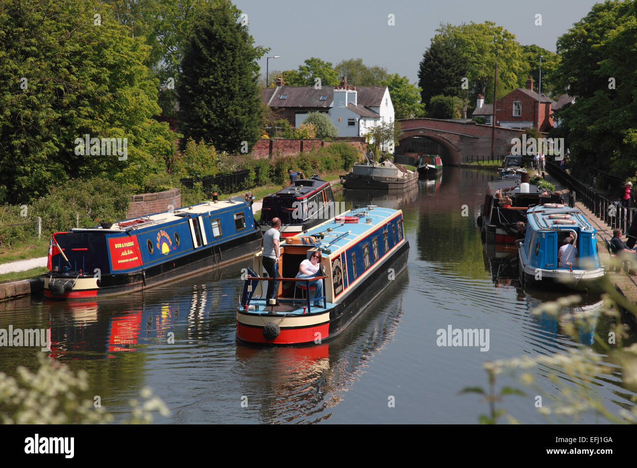Narrowboats on the Bridgewater Canal looking towards Lymm Bridge at Lymm in Cheshire - Stock Image
