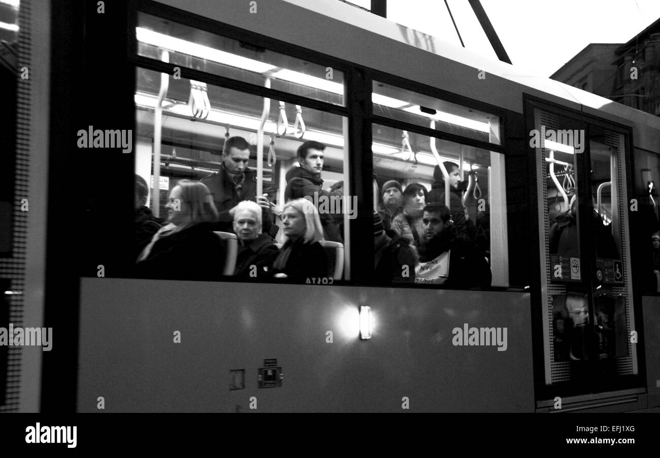 Manchester Lancashire UK - Commuters on a city centre tram at night looking out of the window January 2015 - Stock Image