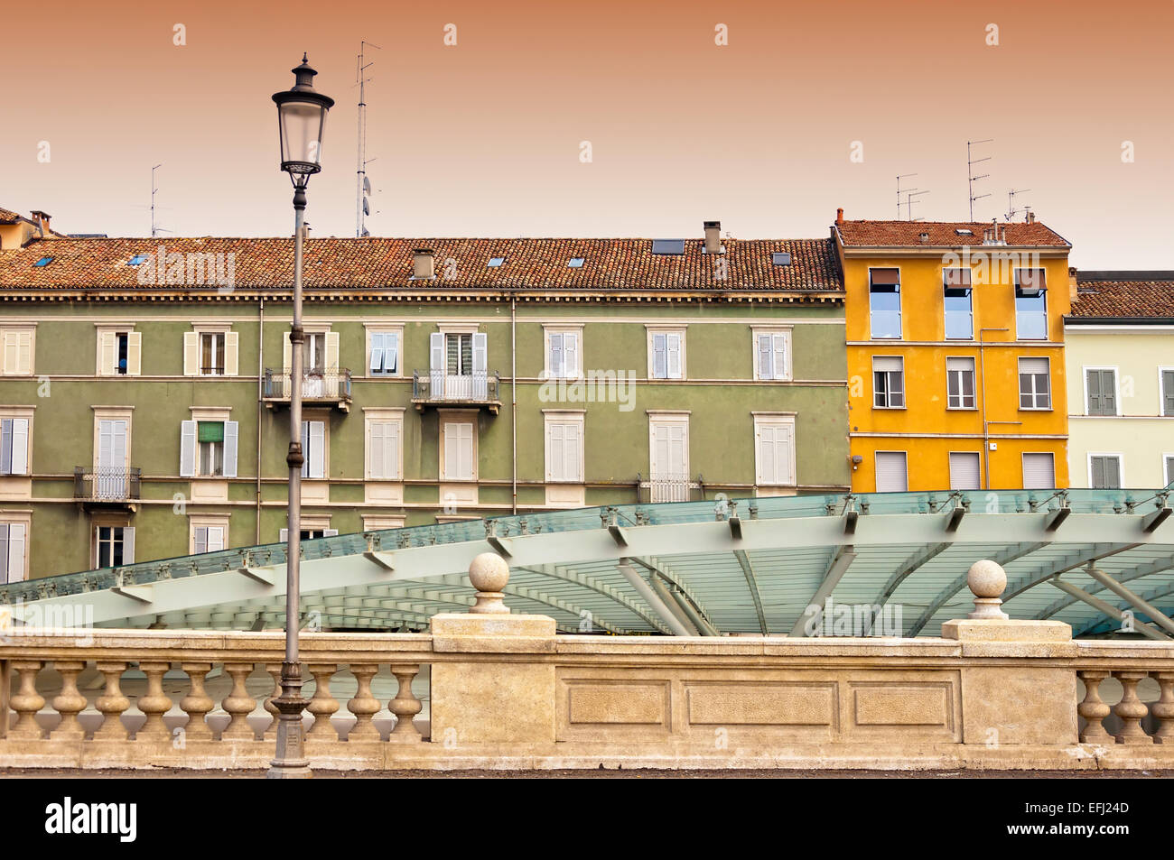 Parma, Italy - Emilia-Romagna region. contrast between colorful Mediterranean architecture and modern glass roof - Stock Image