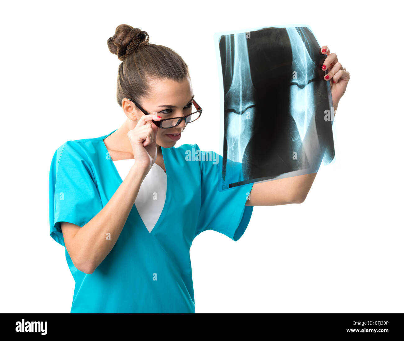 Beautiful radiologist looking at x-ray image - Stock Image