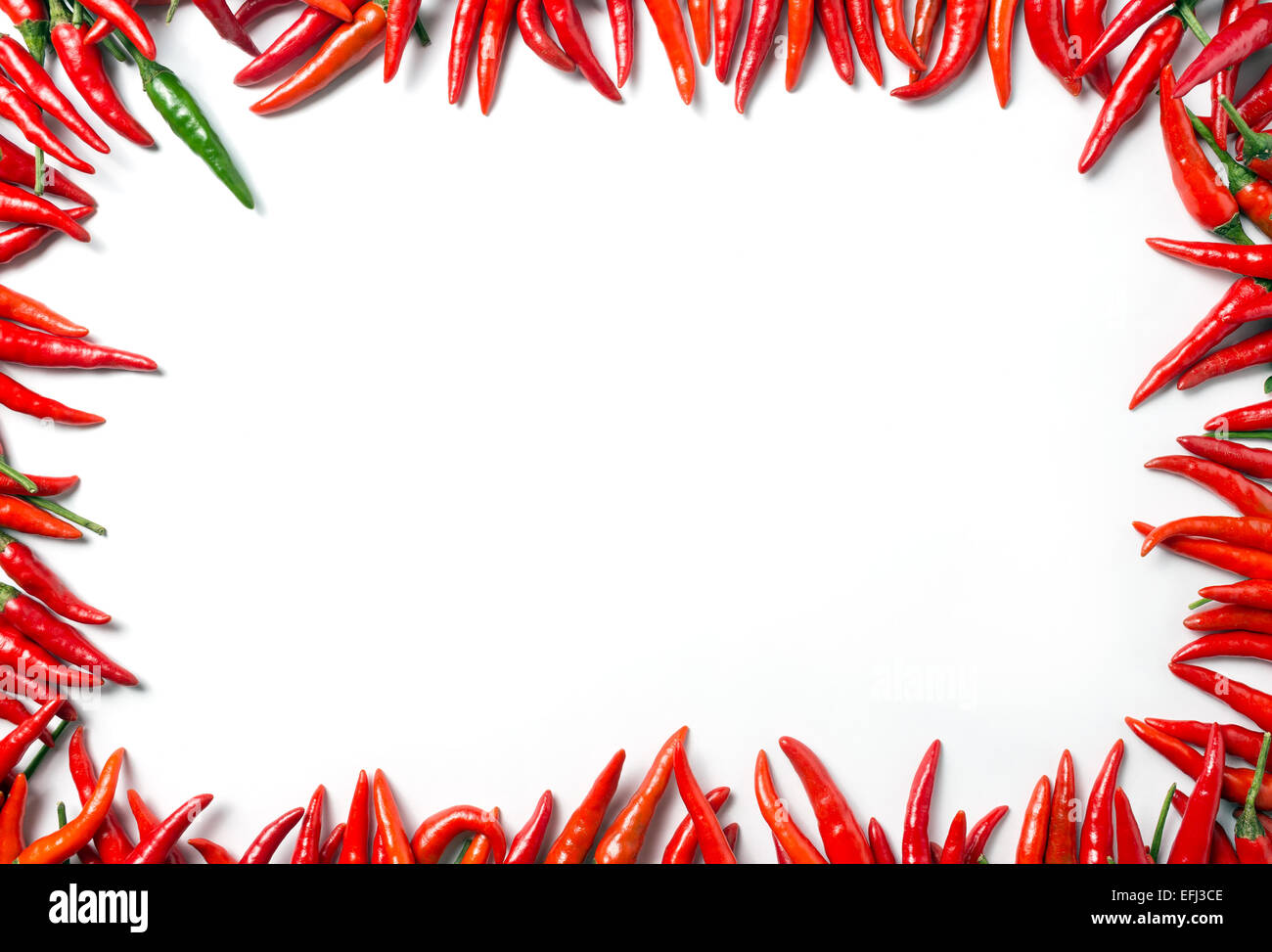 Frame of mini red hot chillies - isolated on white background Stock Photo