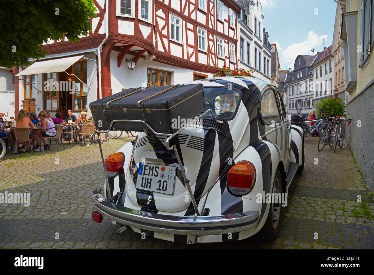 VW beatle car in the old town, Diez on the river Lahn, Westerwald, Rhineland-Palatinate, Germany, Europe - Stock Image