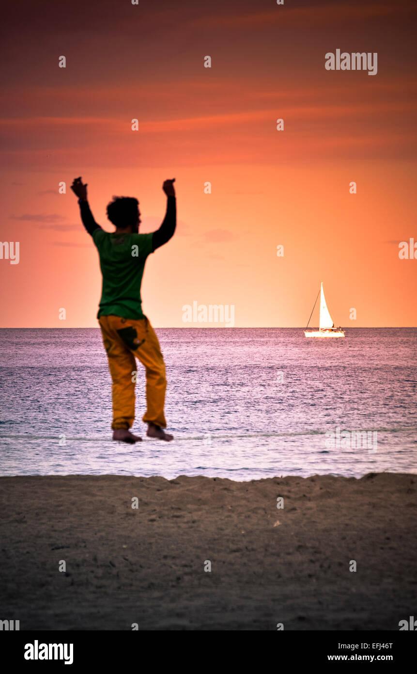 Tightrope Walking man at beach. Barcelona, Catalonia, Spain. - Stock Image