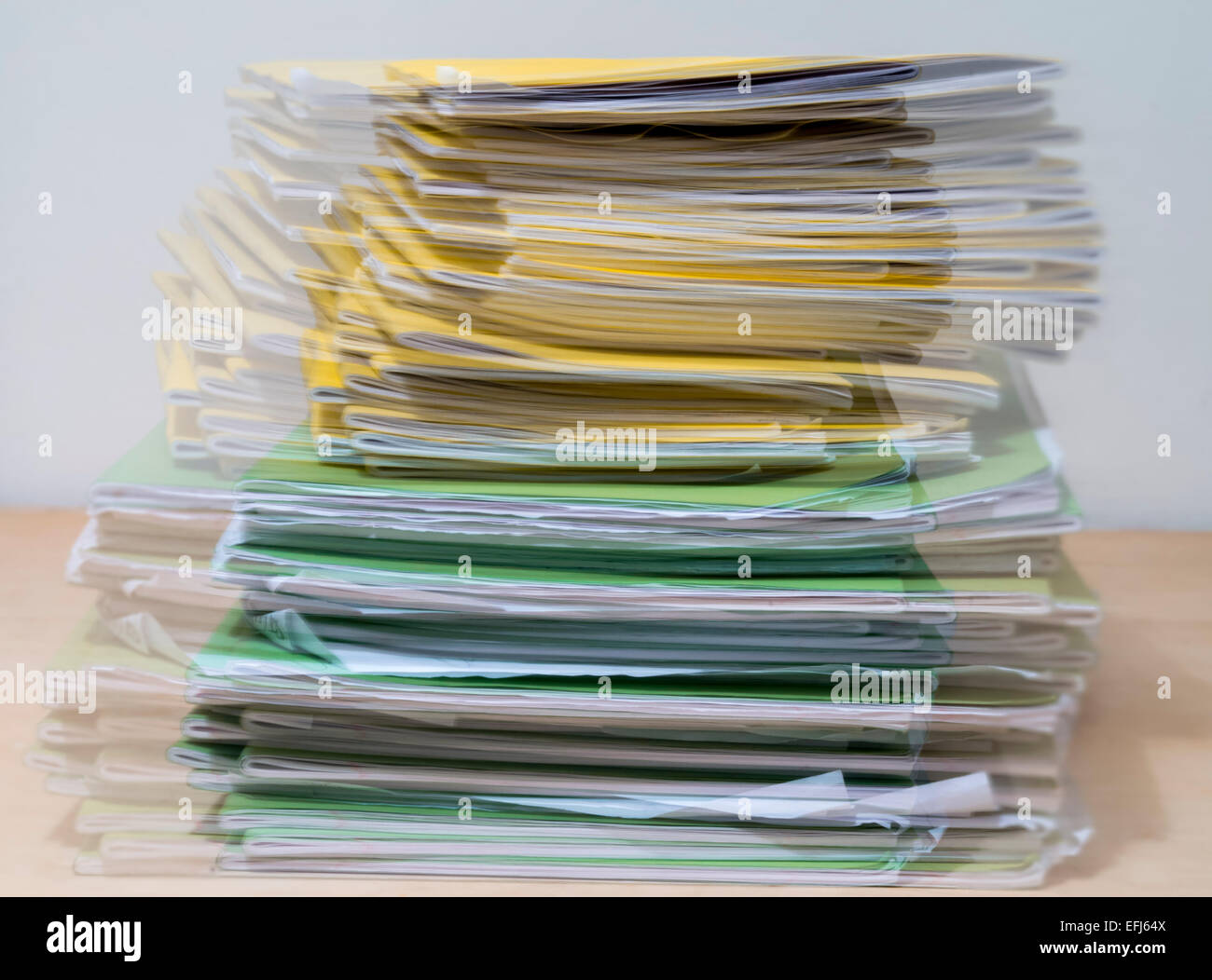 Seeing double/double vision - A large pile of school exercise books for marking by a  teacher - Stock Image