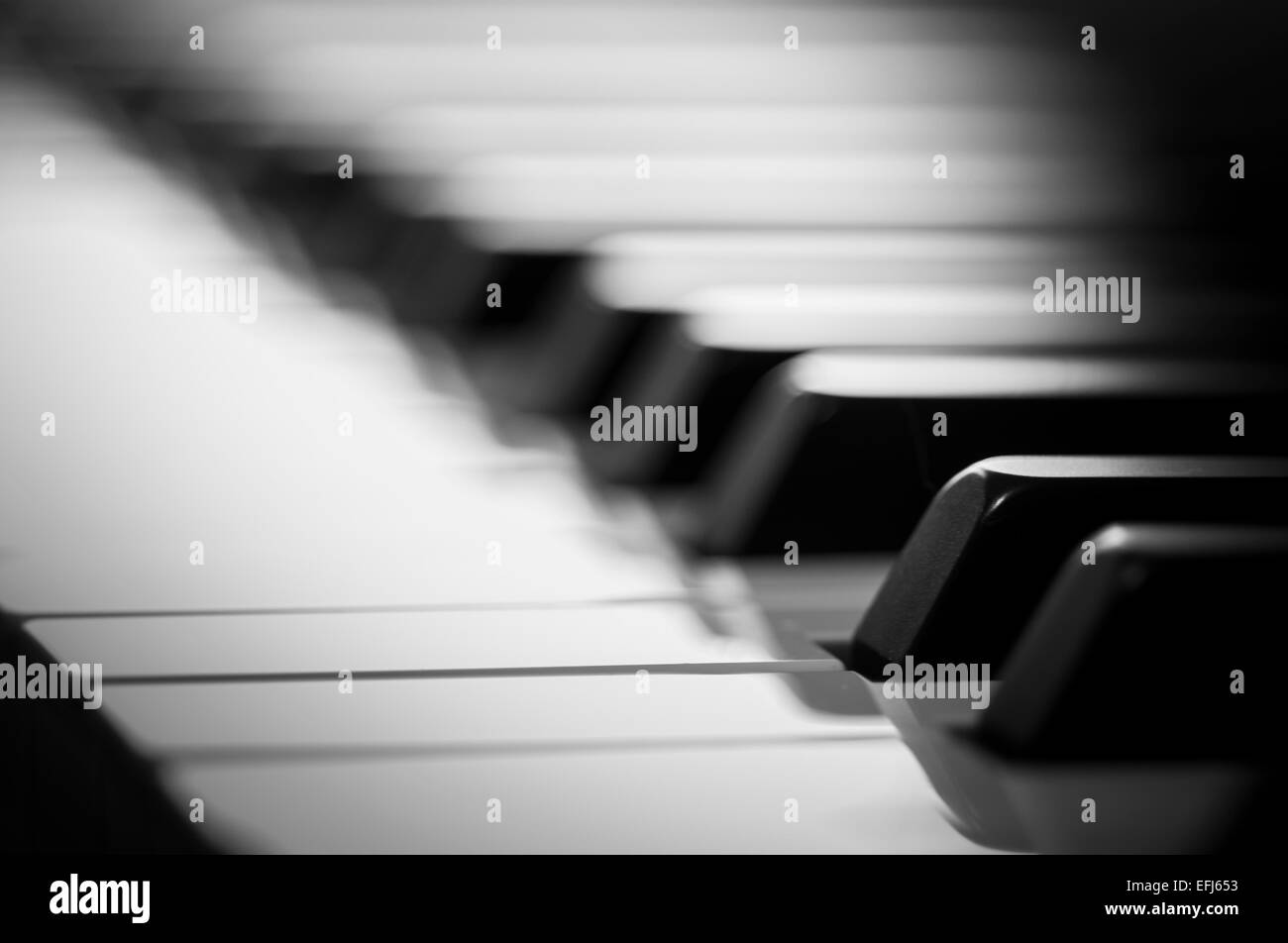 Artistic close up of piano keyboard in black and white with shallow depth of field - Stock Image