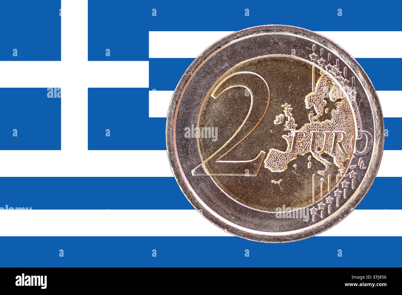 Common face of two euros coin isolated on the national flag of Greece as background - Stock Image