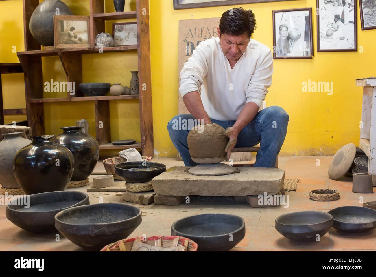 San Bartolo Coyotepec, Mexico - Javier Nieto Castillo demonstrates the making of black pottery at the Doña - Stock Image